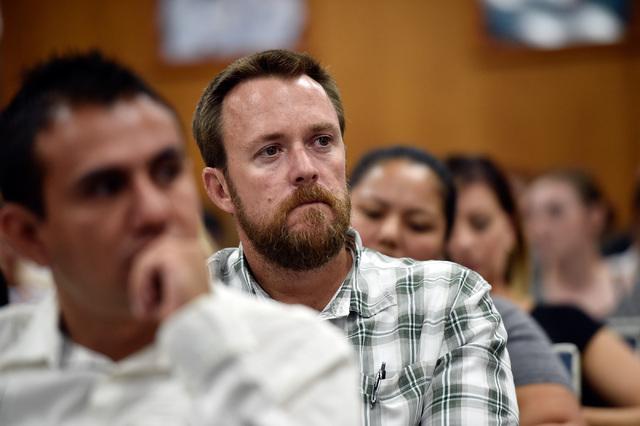 Jason Lamberth listens to speakers during a school board meeting at the Clark County School Board Thursday, Sept. 8, 2016, in Las Vegas. (David Becker/Las Vegas Review-Journal) Follow @davidjaybecker