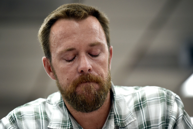 Jason Lamberth holds back tears as he speaks about the suicide last week of a middle school student during a school board meeting at the Clark County School Board Thursday, Sept. 8, 2016, in Las V ...