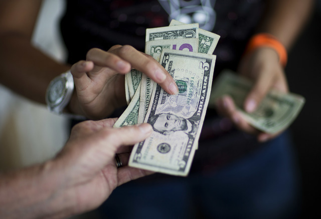 Americans finally got a raise in 2015 after years of stagnating incomes, driven by gains among the poorest households, according to information provided by the Census Bureau, Sept. 13, 2016. (Davi ...