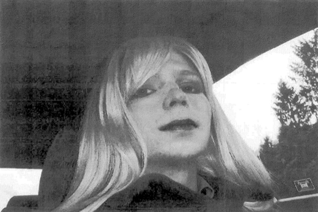 In this undated file photo provided by the U.S. Army, Pfc. Chelsea Manning poses for a photo wearing a wig and lipstick.  (U.S. Army/AP File)