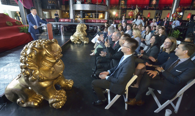 Hou Wei, vice president of Hainan Airlines, left, speaks at a press conference at Drai's in the Cromwell hotel-casino, Aug. 4, 2016, where he announced that the airline will begin non-stop fligh ...