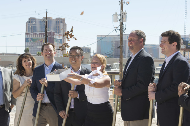 Officials from the Fore Property Company, Argosy Real Estate Partner's and other dignitaries release butterflies to mark the official start of development during a groundbreaking ceremony for the  ...