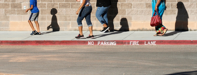 Students and parents are seen around Johnson Junior High School in Las Vegas, Sunday, Sept. 11, 2016. School officials announced Sunday that Monday classes at the school will be canceled while off ...