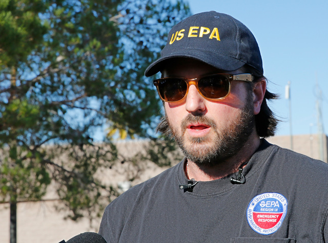 Randy Nattis, federal on-scene coordinator at Environmental Protection Agency, speaks to reporters in front of Johnson Junior High School in Las Vegas, Sunday, Sept. 11, 2016, regarding the cancel ...