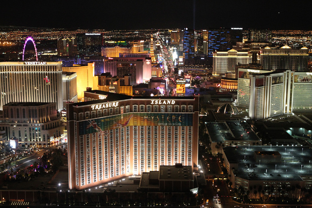 The Strip is seen in this view from the rooftop of the Trump International before hotel and casino lights were dimmed in observance of former UNLV hall of fame basketball coach Jerry Tarkanian Wed ...