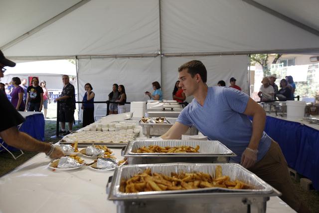 Anthony Kunard prepares gyro plates at the gyro booth during the 44th Annual Greek Food Festival at St. John Greek Orthodox Church in Las Vegas, Sunday, Sept. 18, 2016. Rachel Aston/Las Vegas Revi ...