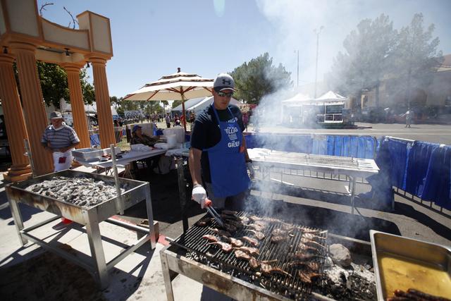 Nick Kelesis grills lamb chops during the 44th Annual Greek Food Festival at St. John Greek Orthodox Church in Las Vegas, Sunday, Sept. 18, 2016. Rachel Aston/Las Vegas Review-Journal Follow @rook ...