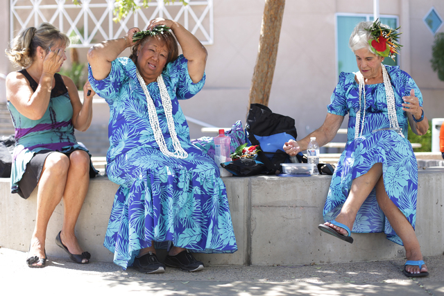 Terry Greene, from left, Jerri Kaina, and Gail Wright of the group Huiomokihana get ready to perform at the Ho'olaule'a Pacific Islands Festival on Sunday, Sept. 11, 2016, at the Henderson Events  ...