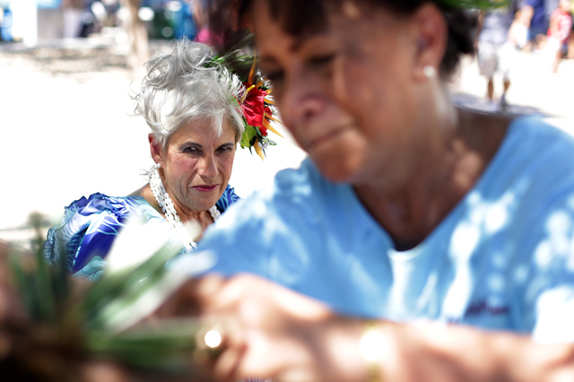 Gail Wright, center, watches on as Sarah Mokihana adjusts the hairpiece of Jerri Kaina before they perform at the Ho'olaule'a Pacific Islands Festival on Sunday, Sept. 11, 2016, at the Henderson E ...