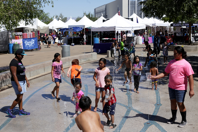 A crowd plays with the water fountain at the Ho'olaule'a Pacific Islands Festival on Sunday, Sept. 11, 2016, at the Henderson Events Plaza in Henderson. Rachel Aston/Las Vegas Review-Journal Follo ...