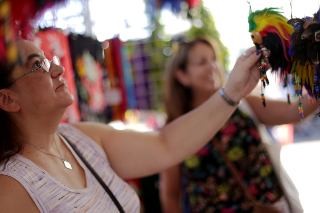 Elaine Wiggins looks at Hawaiian good luck charms for sale at the Ho'olaule'a Pacific Islands Festival on Sunday, Sept. 11, 2016, at the Henderson Events Plaza in Henderson. Rachel Aston/Las Vegas ...