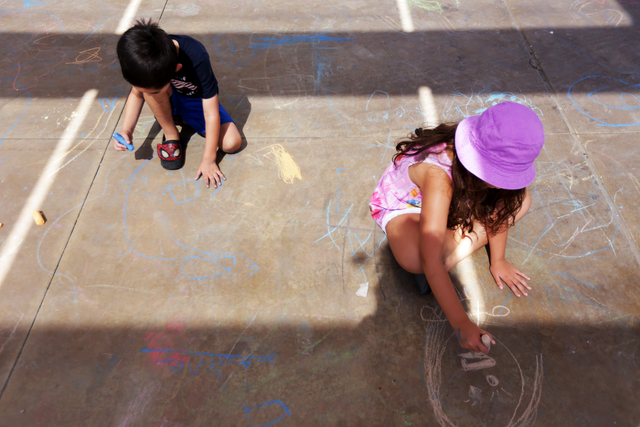 Layne Denslow draws with chalk next to his sister Delilah Denslow at the Ho'olaule'a Pacific Islands Festival on Sunday, Sept. 11, 2016, at the Henderson Events Plaza in Henderson. Rachel Aston/La ...