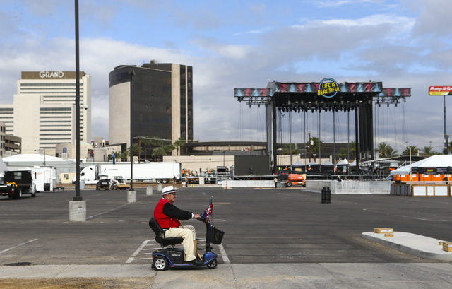 """A man passes by the """"Downtown"""" main stage as setup goes on for the Life is Beautiful music and arts festival in downtown Las Vegas on Wednesday, Sept. 21, 2016. Chase Stevens/Las ..."""