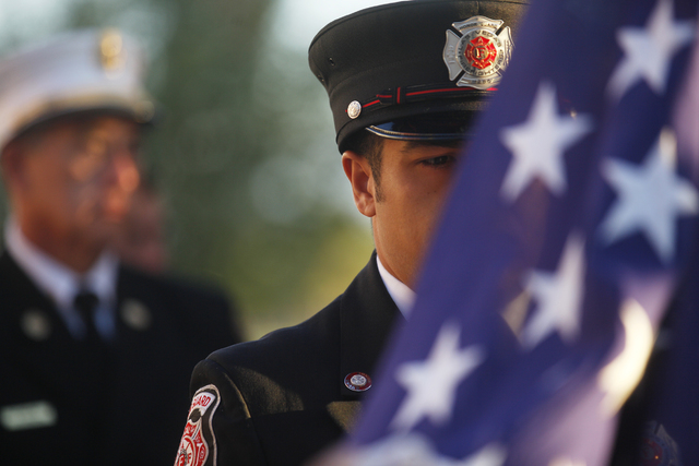 """Las Vegas Fire Department Honor Guard Mario Lueda waits to raise the flag at the 9/11 """"Tolling of the Bells"""" ceremony at Fire Station Five on Sunday, Sept. 11, 2016, in Las Vegas. (Rachel Aston/La ..."""