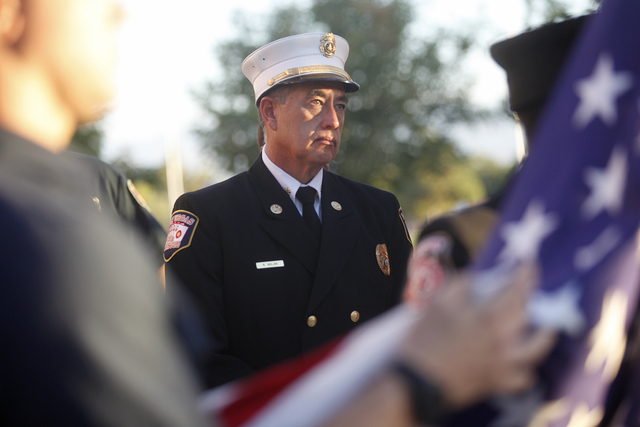 """Las Vegas Deputy Fire Chief Robert Nolan watches as the 9/11 """"Tolling of the Bells"""" ceremony commences at Fire Station Five on Sunday, Sept. 11, 2016, in Las Vegas. (Rachel Aston/Las Vegas Review- ..."""
