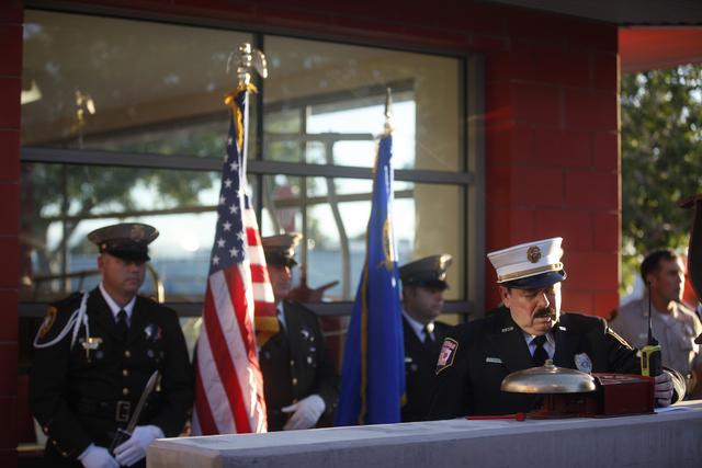 "Las Vegas Fire Department Public Information Officer Tim Szymanksi leads the 9/11 ""Tolling of the Bells"" ceremony at Fire Station Five on Sunday, Sept. 11, 2016, in Las Vegas. (Rachel Aston/Las Ve ..."