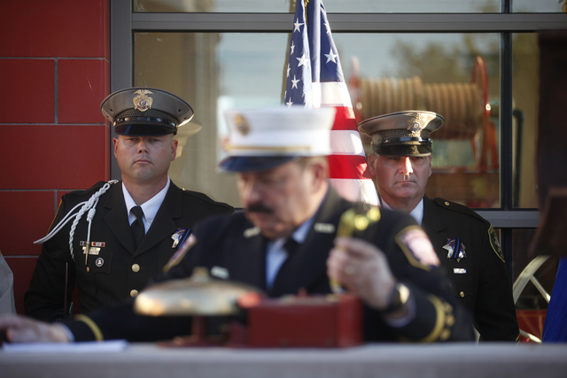 """Las Vegas Fire Department Public Information Officer Tim Szymanksi, center, leads the 9/11 """"Tolling of the Bells"""" ceremony as Metro Honor Guard members Chris Reahm, from left, and Michael Lemley w ..."""