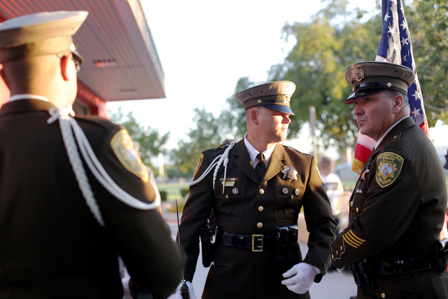 """Las Vegas Fire Department Honor Guard members Chris Reahm, from left, and Michael Lemley, wait before the 9/11 """"Tolling of the Bells"""" ceremony at Fire Station Five on Sunday, Sept. 11, 2016, in La ..."""