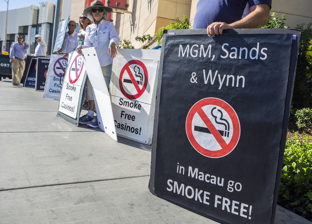Anti-smoking advocates hold signs during a smoke free casino demonstration in front of the Las Vegas Sands Expo and Convention Center on Tuesday , Sept. 27, 2016. Jeff Scheid/Las Vegas Review-Jour ...