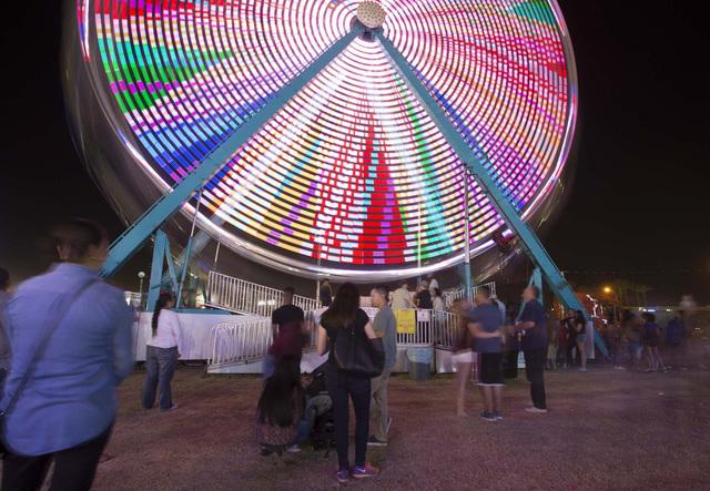 A small crowd gathers around a ferris wheel during the San Gennaro Feast at Craig Ranch Regional Park in North Las Vegas Saturday, Sept. 17, 2016. (Richard Brian/Las Vegas Review-Journal Follow @V ...