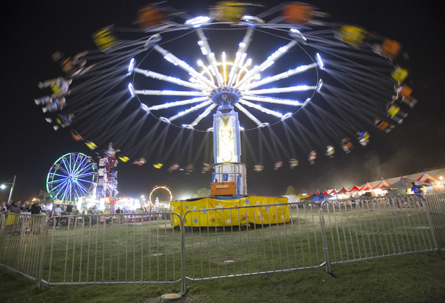 Trill-seekers take a ride on the Yoyo amusement ride during the San Gennaro Feast at Craig Ranch Regional Park in North Las Vegas on Saturday, Sept. 17, 2016. (Richard Brian/Las Vegas) Review-Jour ...