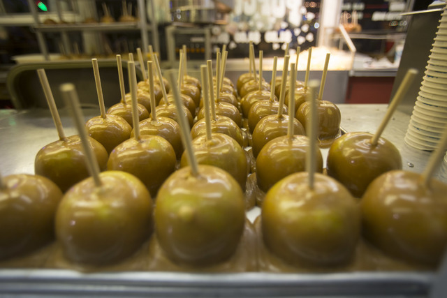 A tray of caramel apples at a vendors booth during the San Gennaro Feast at Craig Ranch Regional Park in North Las Vegas on Saturday, Sept. 17, 2016. (Richard Brian/Las Vegas) Review-Journal Follo ...