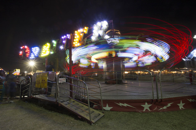 The Orbiter amusement ride creates trails of light as it spins against the night sky during the San Gennaro Feast at Craig Ranch Regional Park in North Las Vegas on Saturday, Sept. 17, 2016.(Richa ...