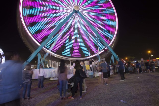 A ferris wheel creates trails of light as it spins against the night sky during the San Gennaro Feast at Craig Ranch Regional Park in North Las Vegas on Saturday, Sept. 17, 2016. Richard Brian/Las ...