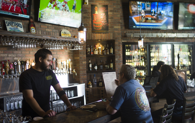 A patron looks at the menu at World of Beer during the restaurant's opening day at the Galleria at Sunset mall in Henderson on Thursday, Sept. 22, 2016. Chase Stevens/Las Vegas Review-Journal Foll ...