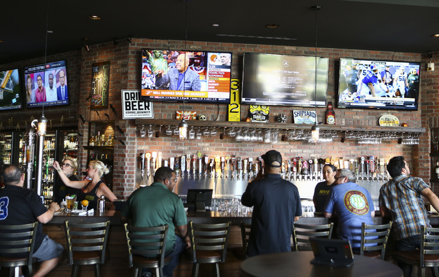 People dine and drink at World of Beer during the restaurant's opening day at the Galleria at Sunset mall in Henderson on Thursday, Sept. 22, 2016. Chase Stevens/Las Vegas Review-Journal Follow @c ...