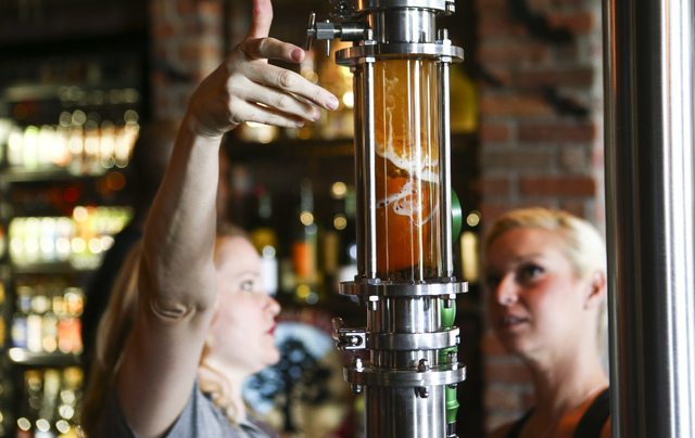 An ale being infused with ingredients including pumpkin, raisins and cinnamon is shown at World of Beer during the restaurant's opening day at the Galleria at Sunset mall in Henderson on Thursday, ...