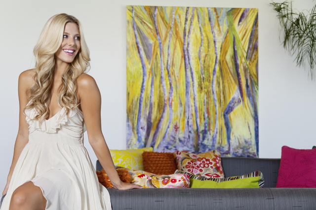 THINKSTOCK Adding bright colors, texture and motion to a neutral wall, this contemporary painting helps tie together the decor, as well as gives depth to the room.