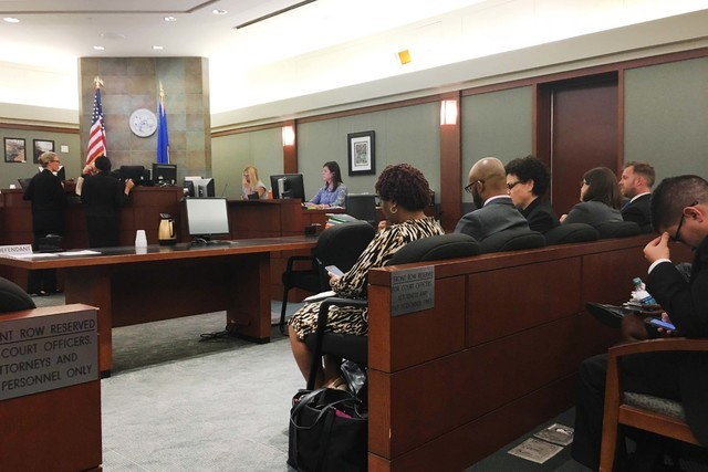 Attorneys sit in District Judge Douglas Herndon's courtroom on Tuesday, Sept. 20, 2016, as other lawyers approach the bench. (David Ferrara/Las Vegas Review-Journal)