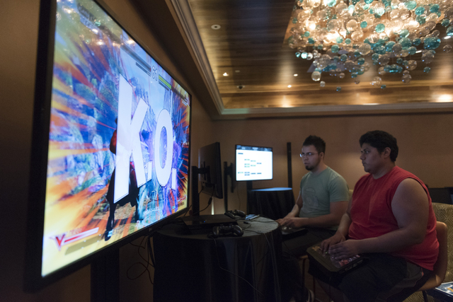 Edgar Briangas, left, and Angel Trejo compete in the Street Fighter V tournament at the Downtown Underground e-sports lounge at Downtown Grand hotel-casino in Las Vegas on Friday, June 3, 2016. (J ...