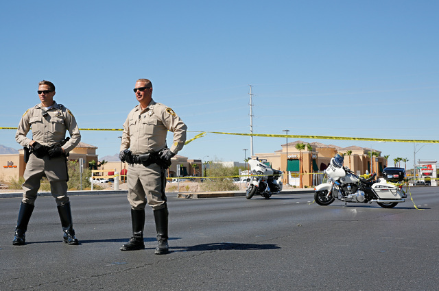 Police officers block off Rainbow Blvd. in Las Vegas, Sunday, Sept. 25, 2016, after a shooting inside a Starbucks at a southwest valley strip mall.  Chitose Suzuki/Las Vegas Review-Journal