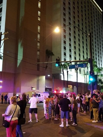 Guests at the Golden Nugget await word that it's OK to go back to their rooms after an early morning fire in the Carson Tower on Thursday. (MICHAEL SHORO/Las Vegas Review-Journal)