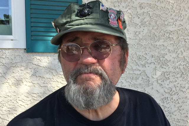 During an interview Friday, Sept. 9, 2016, outside his Las Vegas home, Marine veteran Bill Delaney listens to a question about contaminated water that affected his stomach when he served at Camp L ...