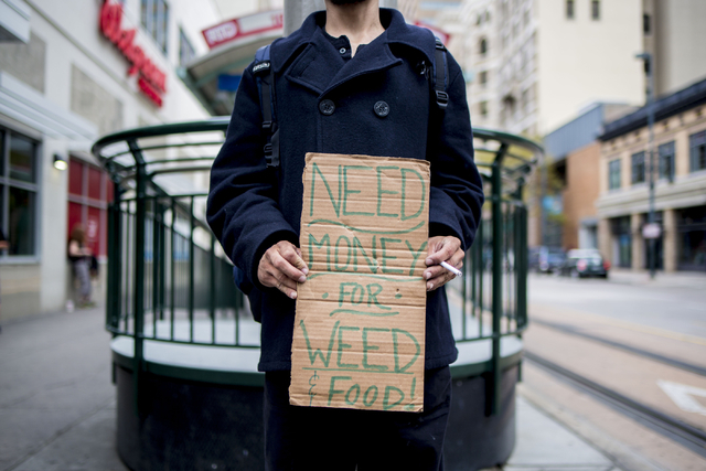 A man stands on the 16th st. mall holding a sign asking for both money and weed Friday, Aug. 2, 2016, in Denver Colorado. Elizabeth Page Brumley/Las Vegas Review-Journal Follow @ELIPAGEPHOTO