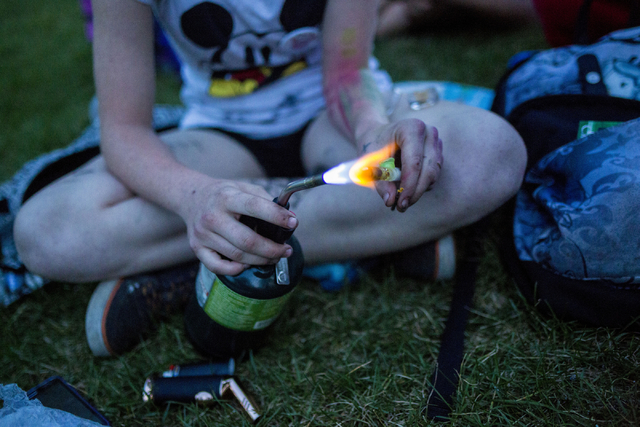 """""""Little Red,"""" 15, prepares to smoke marijuana in Common Park in Denver Colorado, Friday, Sept. 2, 2016. Elizabeth Page Brumley/Las Vegas Review-Journal Follow @ELIPAGEPHOTO"""