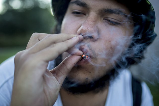 Michel smokes a joint while listening to music and sitting with friends in Common Park in Denver Colorado, Friday, Sept. 2, 2016. Elizabeth Page Brumley/Las Vegas Review-Journal Follow @ELIPAGEPHOTO