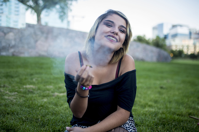 Sabrina Marquez, 17, a Las Vegas native, smokes a joint in Commons Park in Denver Colorado, Friday, Sept. 2, 2016.  Sabrina strongly deals with anxiety, and from a young age has medicated with mar ...