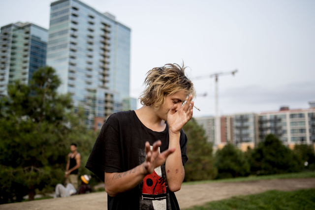 JR smokes a cigarette after taking a hit of marijuana with friends at Common Park, Wednesday, Aug. 31, 2016, in Denver Colorado. Elizabeth Page Brumley/Las Vegas Review-Journal Follow @ELIPAGEPHOTO
