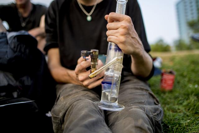 Denver Colorado local Atticus, takes a hit of marijuana in Commons Park, Wednesday, Aug. 31, 2016, in Denver Colorado. Elizabeth Page Brumley/Las Vegas Review-Journal Follow @ELIPAGEPHOTO