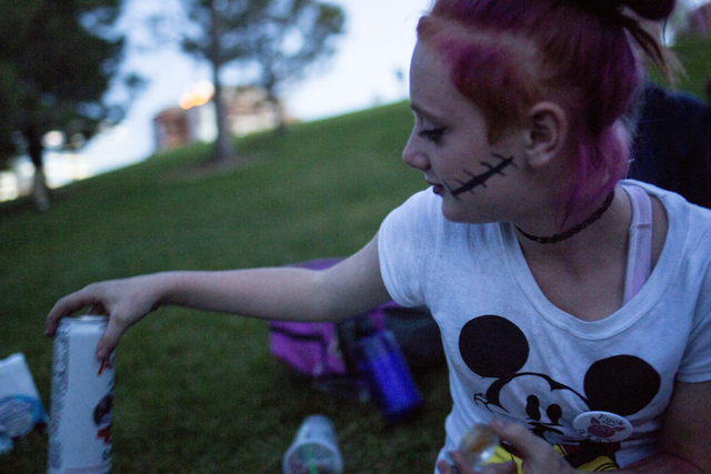 """""""Little Red,"""" 15, holds a container of shatter, a form of marijuana, and passes her beverage to a friend in Common Park in Denver Colorado, Friday, Sept. 2, 2016. Elizabeth Page  ..."""