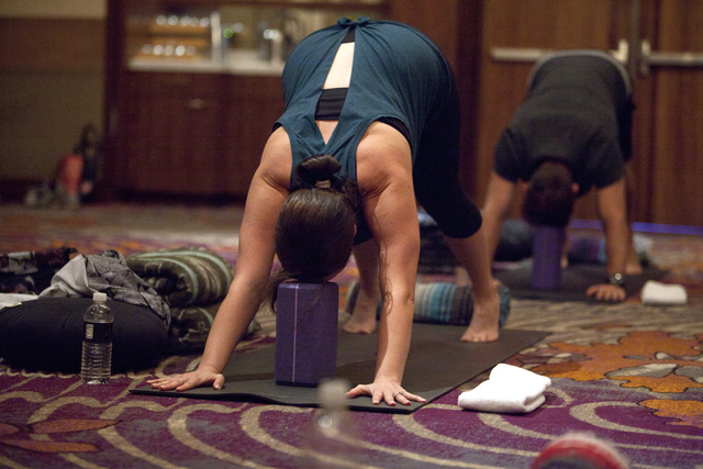 Carissa Eisele, left and Jeremy McCarthy participate in a yoga class, which is part of the new digital detox program at the Mandarin Oriental hotel-casino on Saturday, Sept. 10, 2016, on the Las V ...