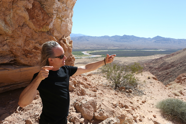 Architect Wendell Burnette of Phoenix shares some thoughts on Double Negative, an earth sculpture by Michael Heizer on Mormon Mesa just northeast of Logandale  on Sept. 15, 2016. (Michael Quine/La ...