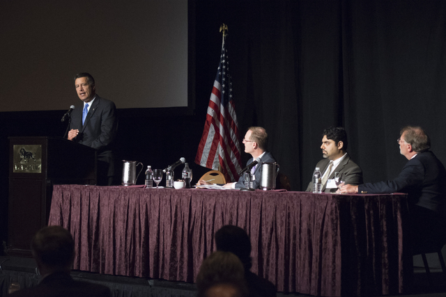 Gov. Brian Sandoval, left, speaks during his Prescription Drug Abuse Prevention Summit at MGM Grand hotel-casino in Las Vegas, Wednesday, Aug. 31, 2016. Scott Pattison, executive director with the ...
