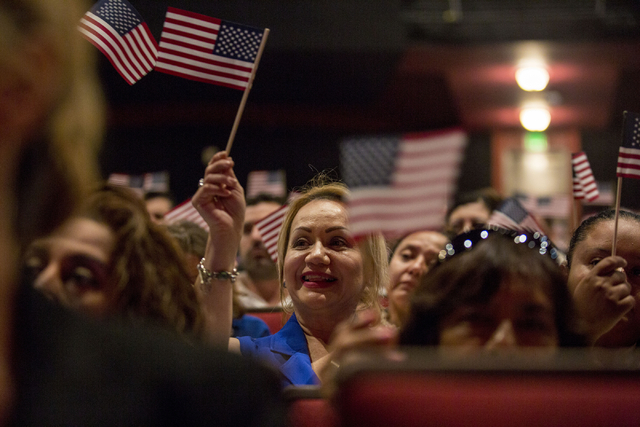 Soledad Romero, center, originally from Mexico, waves a flag during a naturalization ceremony at Cashman Field Thursday, Sept. 22, 2016, in Las Vegas. (Elizabeth Page Brumley/Las Vegas Review-Jour ...