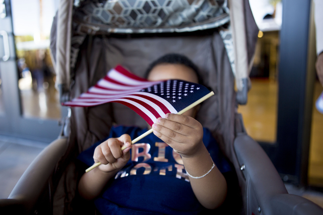 Mohammed Issa, 2, holds a flag after a naturalization ceremony at the Cashman Field Thursday, Sept. 22, 2016, in Las Vegas.  Issa's father, originally from Ethiopia, became a United States citizen ...