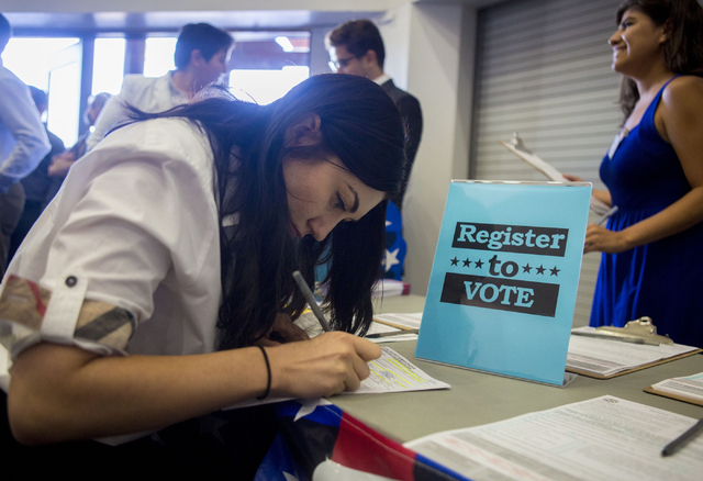 Kseniya Ibragimov, originally from Russia, registers to vote after a Naturalization Ceremony at the Cashman Field, Thursday, Sept. 22, 2016, in Las Vegas. (Elizabeth Page Brumley/Las Vegas Review- ...